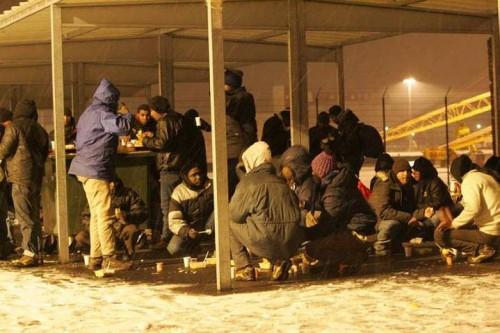 Calais migrants hanger.jpg