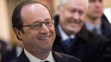 589f1d97c361884e118b45b7.jpg Hollande réjoui.jpg