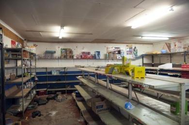 710014-une-epicerie-pillee-dans-un-quartier-pauvre-de-johannesburg-le-23-janvier-2015.jpg