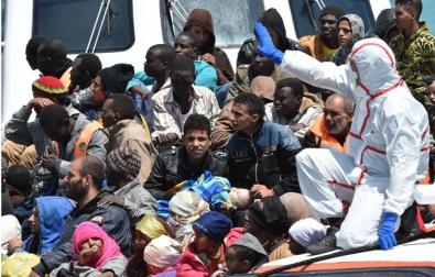 648x415_smigrants-pris-charge-mediterranee-19-mai-2015.jpg migrants.jpg