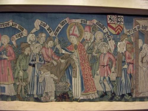 St Adelphe fait l'aumône tapisserie.jpg