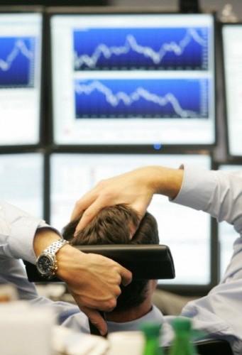 Trader devant ses écrans à la Bourse de francfort.jpg